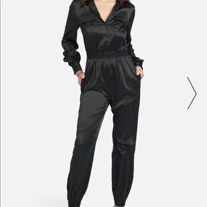 Bebe Black Long Sleeve Jumpsuit SIZE:4